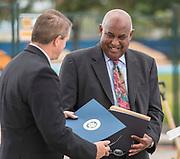 Booker Morris III, right, presents Ross McAlpine, left, with a Congressional certificate from Representative Sheila Jackson Lee during a groundbreaking ceremony at Barbara Jordan Career Center, May 9, 2017.