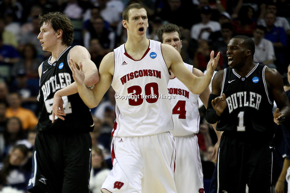 Mar 24, 2011; New Orleans, LA; Wisconsin Badgers forward Jon Leuer (30) reacts following a foul called during the first half of the semifinals of the southeast regional of the 2011 NCAA men's basketball tournament against the Butler Bulldogs at New Orleans Arena.  Mandatory Credit: Derick E. Hingle