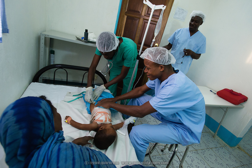 Operating Theatre Nurse, Jean Soro (right), and Anesthisiologist, Moussa Kondo Kalla, preparing Ahamad Ibrahim (19 months) for theatre at the recently completed Médecins Sans Frontières (MSF) surgical unit in Bassikounou, Mauritania on 2 March 2013. The establishment of the unit now means that surgical emergencies no longer have to be referred to the nearest government hospital six-hours drive away.