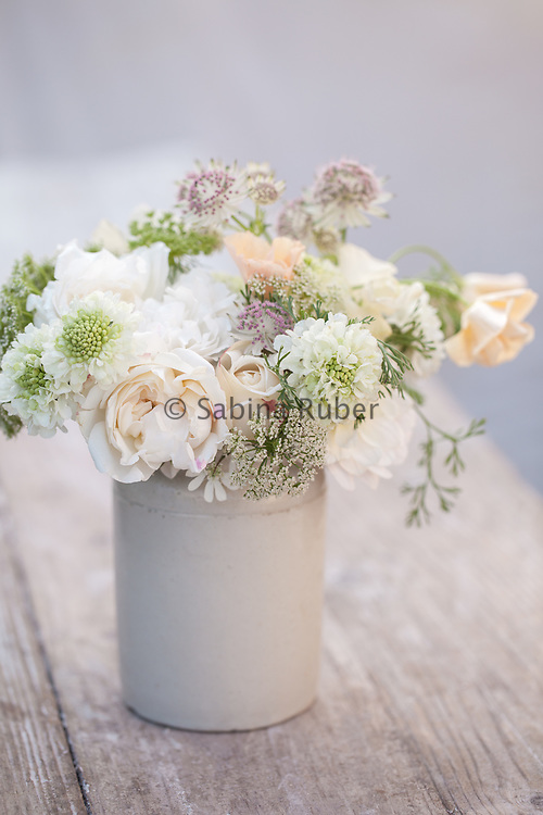 Pale arrangement with white English Roses, Scabious 'Snowmaiden', Ammi visnaga, Astrantia, and Eschscholzia californica 'Peach Sorbet'