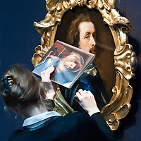 London December 3rd  A Sotheby's expert checks with a special light  an important work of Sir Antony van Dyck that will go on sale  on December 9th  Evening Sale of Old Master and British Painting...***Agreed Fee's Apply To All Image Use***.Marco Secchi /Xianpix. tel +44 (0) 771 7298571. e-mail ms@msecchi.com .www.marcosecchi.com
