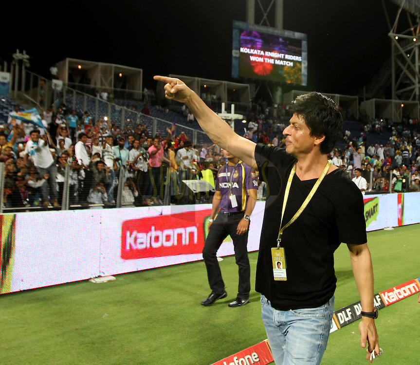 Kolkatta Knight Riders owner Shah Rukh Khan waves towards the crowd after his team won the match 70 of the Indian Premier League ( IPL) 2012  between The Pune Warriors India and the Kolkata Knight Riders held at the Subrata Roy Sahara Stadium, Pune on the 19th May 2012..Photo by Vipin Pawar/IPL/SPORTZPICS