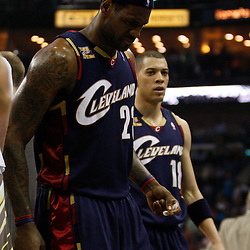 Mar 24, 2010; New Orleans, LA, USA; Cleveland Cavaliers forward LeBron James (23) grimaces as he walks off the court after twisting his ankle during the first half against the New Orleans Hornets at the New Orleans Arena. Mandatory Credit: Derick E. Hingle-US PRESSWIRE