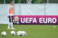 FUSSBALL INTERNATIONAL  EURO 2012   07.06.2012  Training der Deutschen Nationalmannschaft in Danzig Bastian Schweinsteiger (Deutschland) vor einer Werbebande UEFA EURO 2012