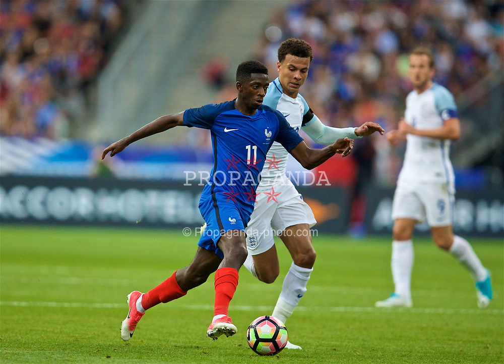 PARIS, FRANCE - Tuesday, June 13, 2017: France's Ousmane Dembélé and England's Dele Alli during an international friendly match at the Stade de France. (Pic by David Rawcliffe/Propaganda)