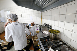 JOHANNESBURG SOUTH AFRICA - MAY 01 Croft & Co staff prepare meals for delivery on May 01, 2020 in Johannesburg South Africa. South Africa moved down to Level 4 of the national lockdown with relaxed restrictions as part of a risk adjusted 5 stage phasing of lockdown measures. This includes allowing of certain restaurants to reopen for trade and prepare hot food as delivered takeaway only. (Photo by Gallo Images/ Dino Lloyd)