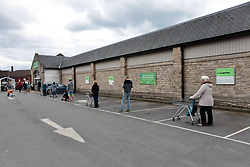 Safe distance queuing outside Co-Operative supermarket during Coronavirus lockdown, Swanage, Dorest UK April 2020