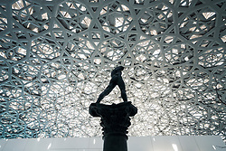 Sculpture Walking Man, On a Column by Auguste Rodin at the Louvre Abu Dhabi at Saadiyat Island Cultural District in Abu Dhabi, UAE. Architect Jean Nouvel