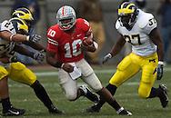 MORNING JOURNAL/DAVID RICHARD&amp;#xA;Troy Smith breaks through the Michigan defense.<br />