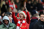 An Arsenal fan in the festive spirit waring a Christmas jumper and hat during the Barclays Premier League match at the Emirates Stadium, London<br /> Picture by David Horn/Focus Images Ltd +44 7545 970036<br /> 13/12/2014