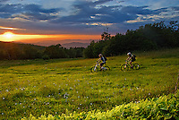 Kristian Jackson and Pace Cooper descend the slopes of Beech Mountain, North Carolina looking towards Tennessee during the Summer Soltice sunset.
