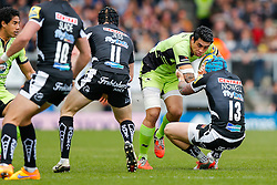Northampton Outside Centre George Pisi is tackled by Exeter Chiefs Outside Centre Jack Nowell - Photo mandatory by-line: Rogan Thomson/JMP - 07966 386802 - 11/04/2015 - SPORT - RUGBY UNION - Exeter, England - Sandy Park Stadium - Exeter Chiefs v Northampton Saints - Aviva Premiership.