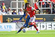 Shrewsbury Town player Callum Lang (9) and Rotherham United player Matt Crooks (17) during the EFL Sky Bet League 1 match between Rotherham United and Shrewsbury Town at the AESSEAL New York Stadium, Rotherham, England on 21 September 2019.