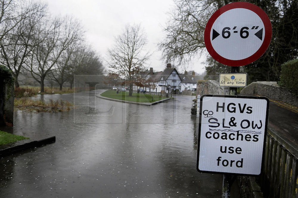 © Licensed to London News Pictures. 28/11/2012.As it continues to rain in the southeast the river Darent in Eynsford, Kent has flooded Eynsford ford prompting someone to write advise on the ford road sign..Photo credit : Grant Falvey/LNP