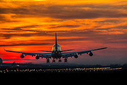 9/3/14 Aircraft land at London Heathrow at Sunset © under license to London News Pictures.<br /> <br /> Photo credit should read IAN SCHOFIELD/LNP