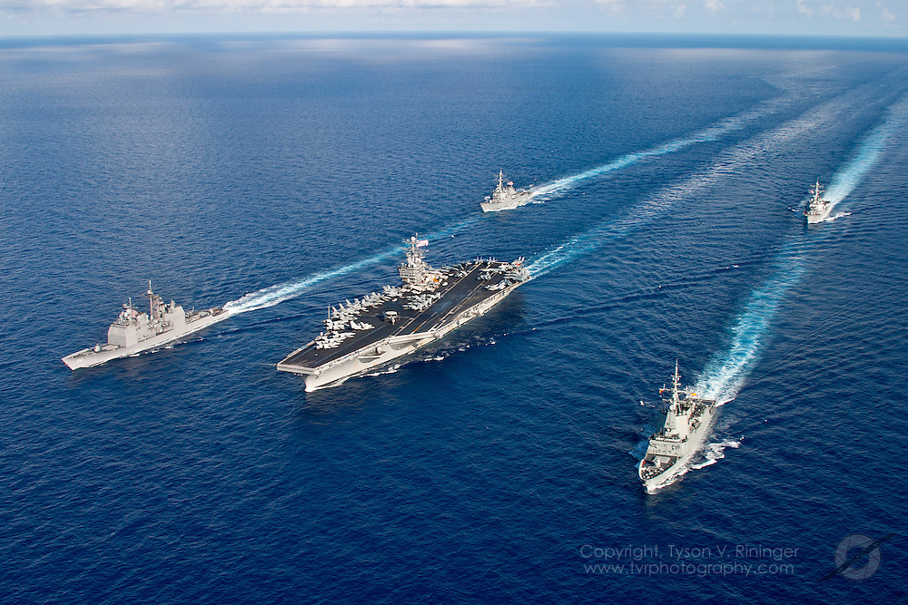 In a show of force, Carrier Strike Group Two (CSG2) consisting of the USS Theodore Roosevelt CVN-71, USS San Jacinto CG-56, USS Donald Cook DDG-75, USS Oscar Austin DDG-79 and the Spanish Frigate Álvaro de Bazán F-101, formate in the Atlantic Ocean off the coast of Florida prior to their 2005-06 Mediterranean deployment...The Spanish Frigate, Álvaro de Bazán was deployed as part of the USS Theodore Roosevelt aircraft carrier battle group in the Persian Gulf. This was the first deployment of a Spanish warship as part of an American naval battle group.