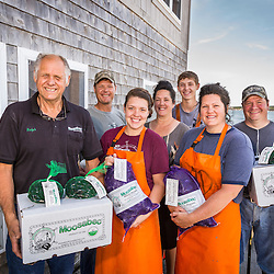 Owner Ralph Smith with family members outside Moosabec Mussels, Inc., in Jonesport, Maine. From left to right: Ralph Smith, Matthew Beal, Micki Beal, Majel Beal, Maverick Beal, Bobbi-Jo Dame, and Roger Dame.