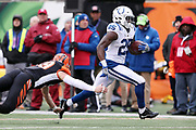 Indianapolis Colts running back Marlon Mack (25) eludes a tackle attempt as he catches a 24 yard touchdown pass for a 20-17 third quarter Colts lead during the 2017 NFL week 8 regular season football game against the Cincinnati Bengals, Sunday, Oct. 29, 2017 in Cincinnati. The Bengals won the game 24-23. (©Paul Anthony Spinelli)