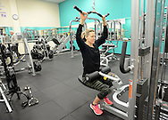 Diane Jenet of Warrington, Pennsylvania stretch her arms to pull a hoist machine after the grand opening of the Warminster YMCA Tuesday, January 31, 2017 in Warminster. Pennsylvania. (Photo by William Thomas Cain)
