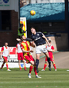 12th May 2018, Dens Park, Dundee, Scotland; Scottish Premier League football, Dundee versus Partick Thistle; Dan Jefferies of Dundee heads clear from Adam Barton of Partick Thistle