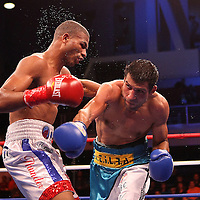 Thomas Dulorme (left)  and Luis Carlos Abregu (L) fight for the WBC International title during the HBO Triple Explosion fight at the Turning Stone Resort Casino in Verona, NY, on Saturday, Oct 27, 2012.  Abregu won the bout by TKO in the 7th round.(AP Photo/Alex Menendez)