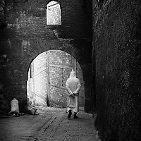 Moroccan man taling a stroll in an alley