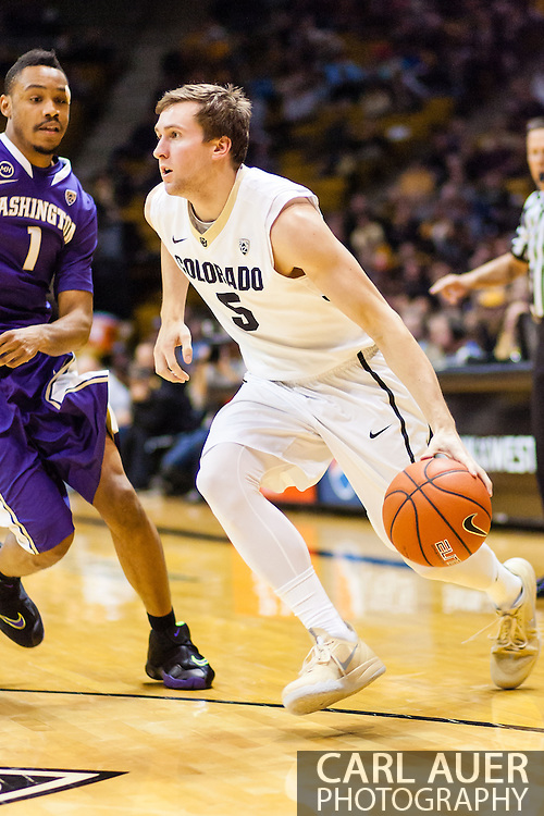 February 9th, 2014:  Colorado Buffaloes sophomore guard Eli Stalzer (5) drives the ball past Washington Huskies freshman guard Darin Johnson (1) in the second half of the NCAA Basketball game between the Washington Huskies and the University of Colorado Buffaloes at the Coors Events Center in Boulder, Colorado