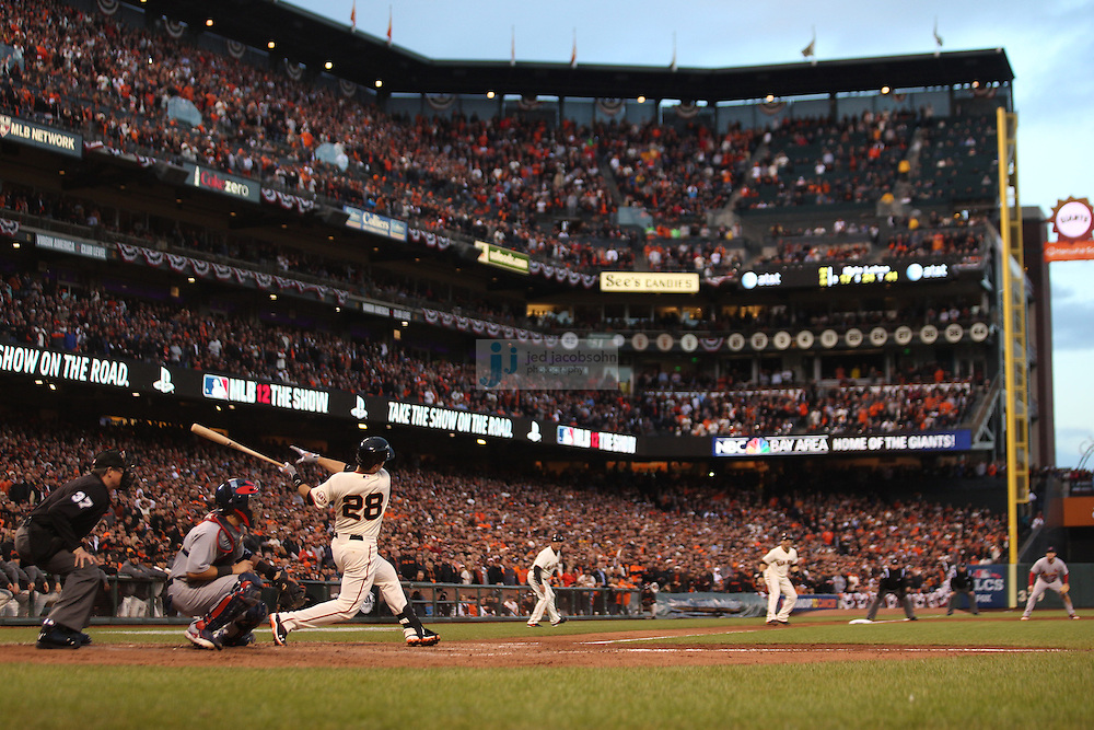 Buster Posey of the San Francisco Giants and the St. Louis Cardinals during Game Seven of the National League Championship Series at AT&T Park on October 22, 2012 in San Francisco, California.  (photo by Jed Jacobsohn)