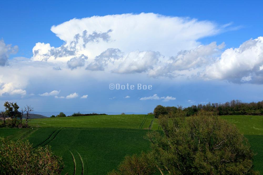 landscape with large wind swept cloud
