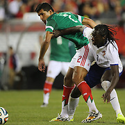 Éder, (right), Portugal,  challenges Francisco Rodríguez, Mexico, during the Portugal V Mexico International Friendly match in preparation for the 2014 FIFA World Cup in Brazil. Gillette Stadium, Boston (Foxborough), Massachusetts, USA. 6th June 2014. Photo Tim Clayton