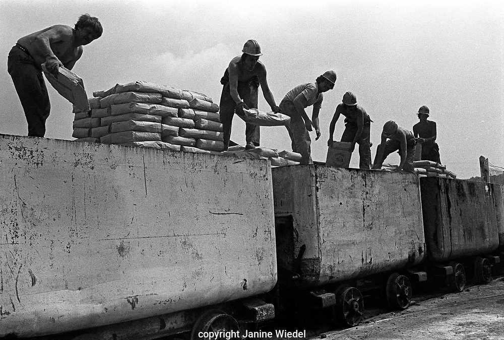 Surface worker at Florence Colliery loading coal onto trains for transport.