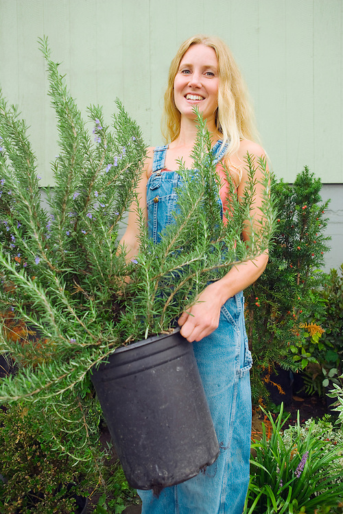 Portrait of a young woman working in a plant nursery