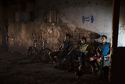 August 1, 2018 - Gaza, Gaza Strip, Palestine - Palestinian men seen sitting outside in front of their house during a blackout in the Jabalya refugee camp in the Gaza Strip. Most Palestinians in the Gaza Strip use batteries, generators or candles to light their homes during blackout. (Credit Image: © Mahmoud Issa/SOPA Images via ZUMA Wire)