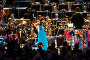 The Last Night of the BBC Proms at the Royal Albert Hall, London -  With the usual wide range of popular music including - a Mary Poppins medley, Ol Man River, the Sabre Dance, Rule Britannia, Pomp and Circumstance and Jerusalem. Performed by conductor, Sakari Oramo, the BBC Symphony Orchestra, Chorus and Singers with soloists including Ruthie Henshall and 	Janine Jansen (violin, blue dress, pictured). PRESS ASSOCIATION Photo. Picture date: Saturday September 13, 2014. Photo credit should read: Guy Bell/PA Wire