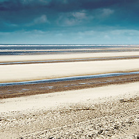 Looking out to sea over Holkham beach towards the north Norfolk wind farm at Sheringham Shoal