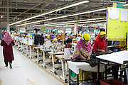 Garment workers at work on sewing machines inside  Epyllion Group garment factory in Bangladesh.