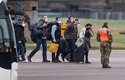 © Licensed to London News Pictures. 09/02/2020. Brize Norton, UK. Passengers disembark from a charter flight carrying Britons evacuated from Wuhan , China after it arrived at RAF Brize Norton in Oxfordshire. Fears of the spread of the corona virus have lead to this third charter flight being organised to bring 200 people to the UK. The passengers will be quarantined at a facility in Milton Keynes for 14 days. Photo credit: Peter Macdiarmid/LNP