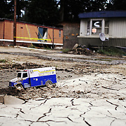 A toy ambulance is frozen in the dried and cracked mud that coats much of Holly Acres mobile home park in the aftermath of the flood that virtually demolished the park in Woodbridge, VA, on Thursday, September 8, 2011.  A week later, nearly 70 trailer homes were either condemned or destroyed, and the families have scrambled to find somewhere to live, often staying in temporary shelters offered by the Red Cross.  Many residents contend that Prince William County neglected to maintain a nearby culvert which could have caused or exacerbated the flooding. For The News & Messenger (Manassas, VA)