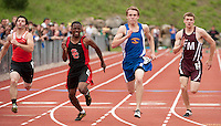 Parker Hansen of Kearsarge High School crosses the finish line during the 100 meter final during the NHIAA DIvision III State Track Championships at Newfound High School on Saturday.  (Karen Bobotas/for the Concord Monitor)