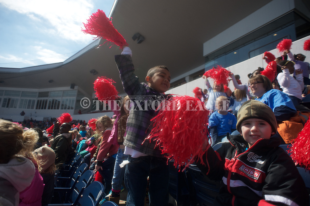 Students cheer during the first Kids Day game, at Ole Miss vs. Southeastern Louisiana at Oxford-University Stadium in Oxford, Miss. on Wednesday, March 6, 2013. Ole Miss won 6-2.