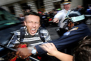 A man is arrested as people participating the Occupy Wall Street protest march near the New York Stock Exchange in New York, New York, on October 12, 2011.