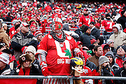 Ohio State fan 'Big Nut' holds onto a Michigan head during the game at Ohio Stadium on 11/24/2012. (Photo by Joe Robbins)