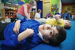 Disabled child having foot massage,