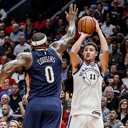 Oct 20, 2017; New Orleans, LA, USA; Golden State Warriors guard Klay Thompson (11) shoots over New Orleans Pelicans forward DeMarcus Cousins (0) during the first quarter of a game at the Smoothie King Center. The Warriors defeated the Pelicans 128-120. Mandatory Credit: Derick E. Hingle-USA TODAY Sports