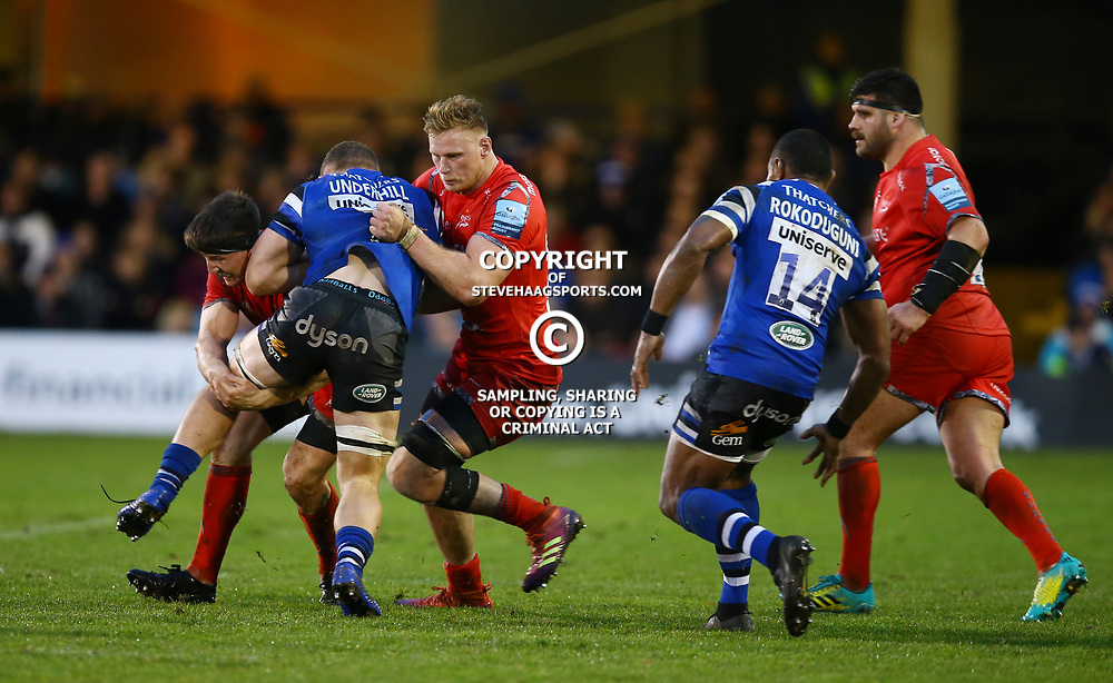 Ben Curry andJean-Luc du Preez of Sale Sharks look to tackle Sam Underhill of Bath Rugby during the Gallagher Premiership match between Bath Rugby and Sale Sharks at the The Recreation Ground Bath England.2nd December 2018,(Photo by Steve Haag Sports)