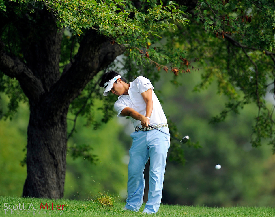 Aug 14, 2009; Chaska, MN, USA; Ryuji Imada (JPN) hits out of the rough on the third hole during the second round of the 2009 PGA Championship at Hazeltine National Golf Club.  ©2009 Scott A. Miller