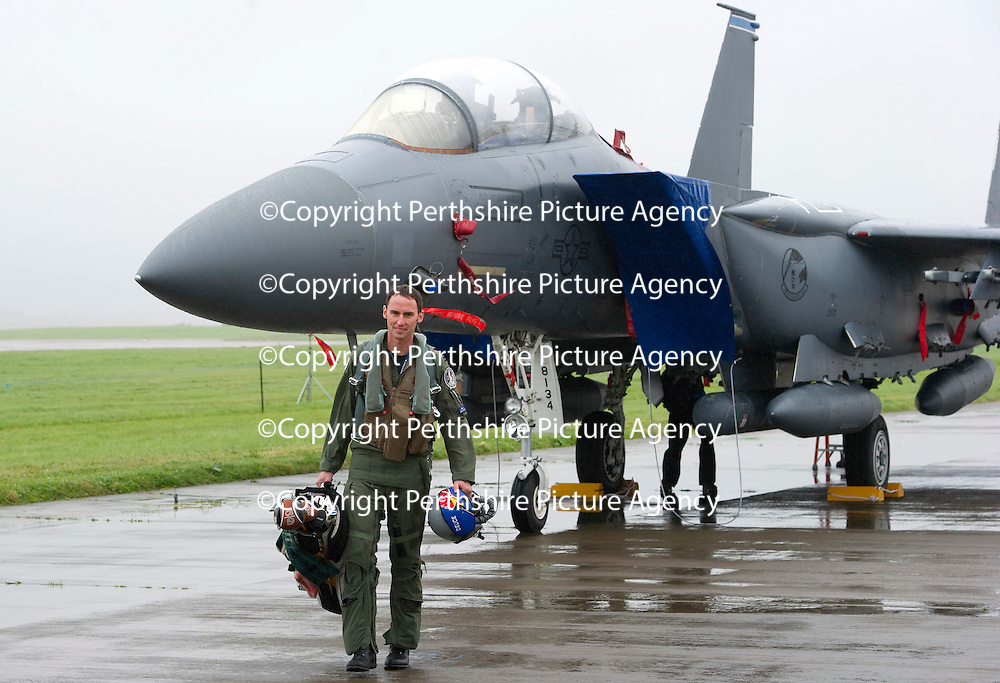 RAF Leuchars Airshow preview...09.09.11<br /> Low cloud and rain put paid to most of the flying activity at RAF Leuchars today with most aircraft grounded due to the weather. One of the few arrivals for the airshow were a pair of US Air Force F15E's. Pictured Captain Jared Mandella of the 492nd Fighter Squadron at RAF Lakenheath hoping the weather will improve enough to alllow him and his colleagues to get in a round of golf at St Andrews. With the announcement that RAF Leuchars is to be closed no-one knows whether this will be the last Airshow in Fife.<br /> Picture by Graeme Hart.<br /> Copyright Perthshire Picture Agency<br /> Tel: 01738 623350  Mobile: 07990 594431