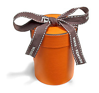 orange and brown leather container by hermes-paris