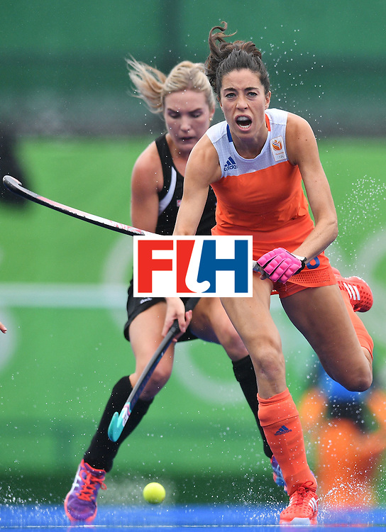Netherlands' Naomi As van controls the ball during the womens's field hockey New Zealand vs Netherlands match of the Rio 2016 Olympics Games at the Olympic Hockey Centre in Rio de Janeiro on August, 12 2016. / AFP / Carl DE SOUZA        (Photo credit should read CARL DE SOUZA/AFP/Getty Images)