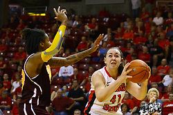 15 March 2012:  Marley Hall has 2 points in mind as she is confronted by Crystal Bradford during a first round WNIT basketball game between the Central Michigan Chippewas and the Illinois Sate Redbirds at Redbird Arena in Normal IL